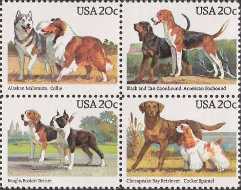 Block of four 20-cent U.S. postage stamps picturing dogs