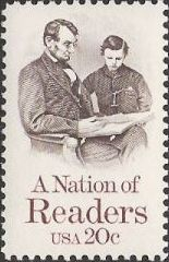 Brown & maroon 20-cent U.S. postage stamp picturing Abraham and Tad Lincoln