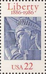 Blue & red 22-cent U.S. postage stamp picturing Statue of Liberty