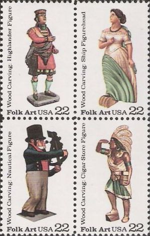 Block of four 22-cent U.S. postage stamps picturing carved wooden figures
