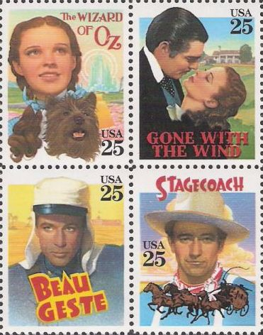 Block of four 25-cent U.S. postage stamps picturing characters from The Wizard of Oz, Gone With the Wind, Beau Geste, and Stagecoach