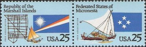 Pair of 25-cent U.S. postage stamps picturing boats and flags of Republic of the Marshall Islands and Federated States of Micronesia