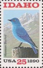 25-cent U.S. postage stamp picturing mountain bluebird and mountains