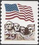 29-cent U.S. postage stamp picturing American flag over Mt. Rushmore