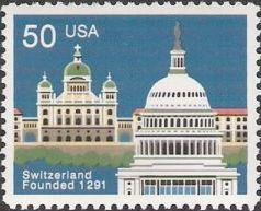 50-cent U.S. postage stamp picturing U.S. Capitol and Swiss building