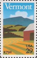 29-cent U.S. postage stamp picturing barn, field, and hills