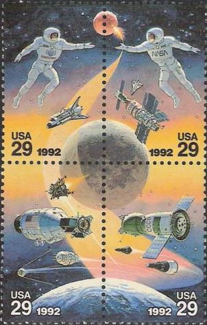 Block of four 29-cent U.S. postage stamps picturing astronauts, spacecraft, and planets