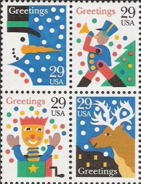 Block of four 29-cent U.S. postage stamps picturing snowman, toy soldier, jack in the box, and reindeer