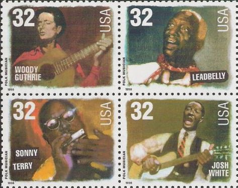 Block of four 32-cent U.S. postage stamps picturing Woody Guthrie, Leadbelly, Sonny Terry, and Josh White
