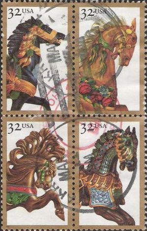 Block of four 32-cent U.S. postage stamps picturing carousel horses