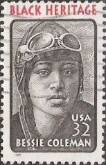Black & red 32-cent U.S. postage stamp picturing Bessie Coleman