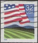 32-cent U.S. postage stamp picturing American flag over field