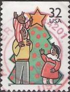 32-cent U.S. postage stamp picturing man and children decorating Christmas Tree