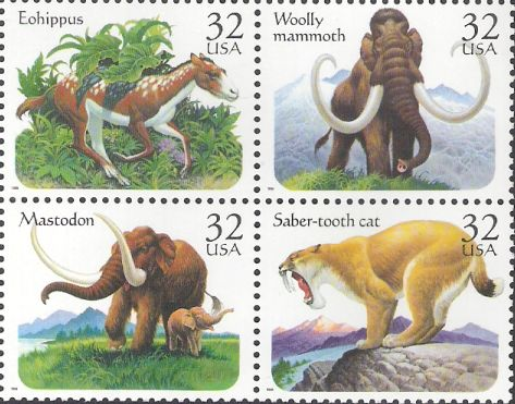 Block of four 32-cent U.S. postage stamps picturing prehistoric animals