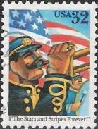 32-cent U.S. postage stamp picturing American flag and marching band members