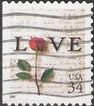 34-cent U.S. postage stamp picturing love letter and rose
