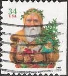 34-cent U.S. postage stamp picturing Santa Claus holding toys and tree