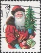 34-cent U.S. postage stamp picturing Santa Claus holding tree and drum