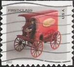 Non-denominated 37-cent U.S. postage stamp picturing toy mail wagon