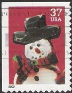 37-cent U.S. postage stamp picturing snowman wearing red and green scarf
