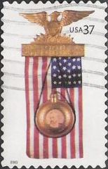 37-cent U.S. postage stamp pcituring presidential campaign badge and American flag