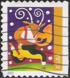 37-cent U.S. postage stamp picturing reindeer playing horn