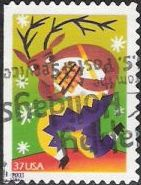 37-cent U.S. postage stamp picturing reindeer playing pan pipes