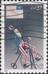 37-cent U.S. postage stamp picturing toy Uncle Sam on bicycle with flag