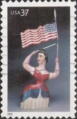 37-cent U.S. postage stamp picturing figure of woman with American flag and sword