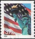 39-cent U.S. postage stamp picturing American flag and Statue of Liberty