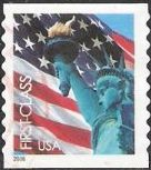Non-denominated 39-cent U.S. postage stamp picturing American flag and Statue of Liberty