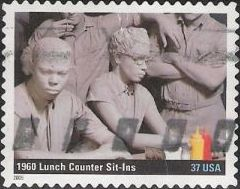 37-cent U.S. postage stamp picturing sculpture of people sitting in restaurant