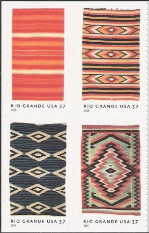 Block of four 37-cent U.S. postage stamps picturing blankets