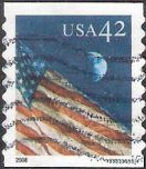 42-cent U.S. postage stamp picturing American flag and moon