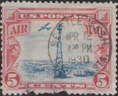 Red & blue 5-cent U.S. postage stamp picturing beacon and airplane