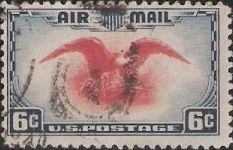Blue & red 6-cent U.S. postage stamp picturing eagle holding shield