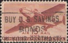 Brown 15-cent U.S. postage stamp picturing airplane
