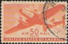 Orange 30-cent U.S. postage stamp picturing airplane