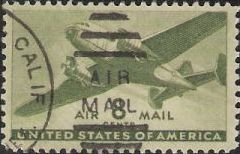 Green 8-cent U.S. postage stamp picturing airplane