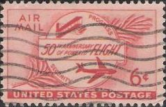 Red 6-cent U.S. postage stamp picturing airplanes