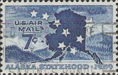 Blue 7-cent U.S. postage stamp picturing mountains and outline of Alaska