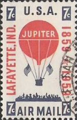 Red & blue 7-cent U.S. postage stamp picturing hot air balloon and crowd of people
