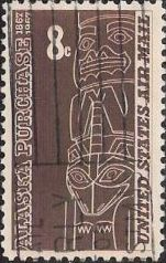 Brown 8-cent U.S. postage stamp picturing totem pole