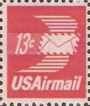 Red 13-cent U.S. postage stamp picturing winged envelope