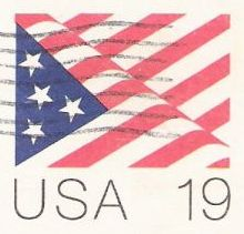 19-cent U.S. postal card picturing American flag